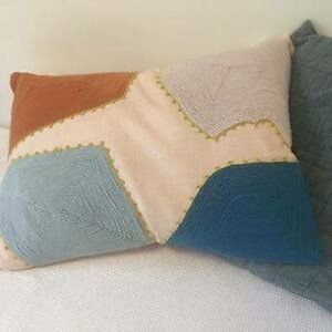 Feather filled embroidered cushion